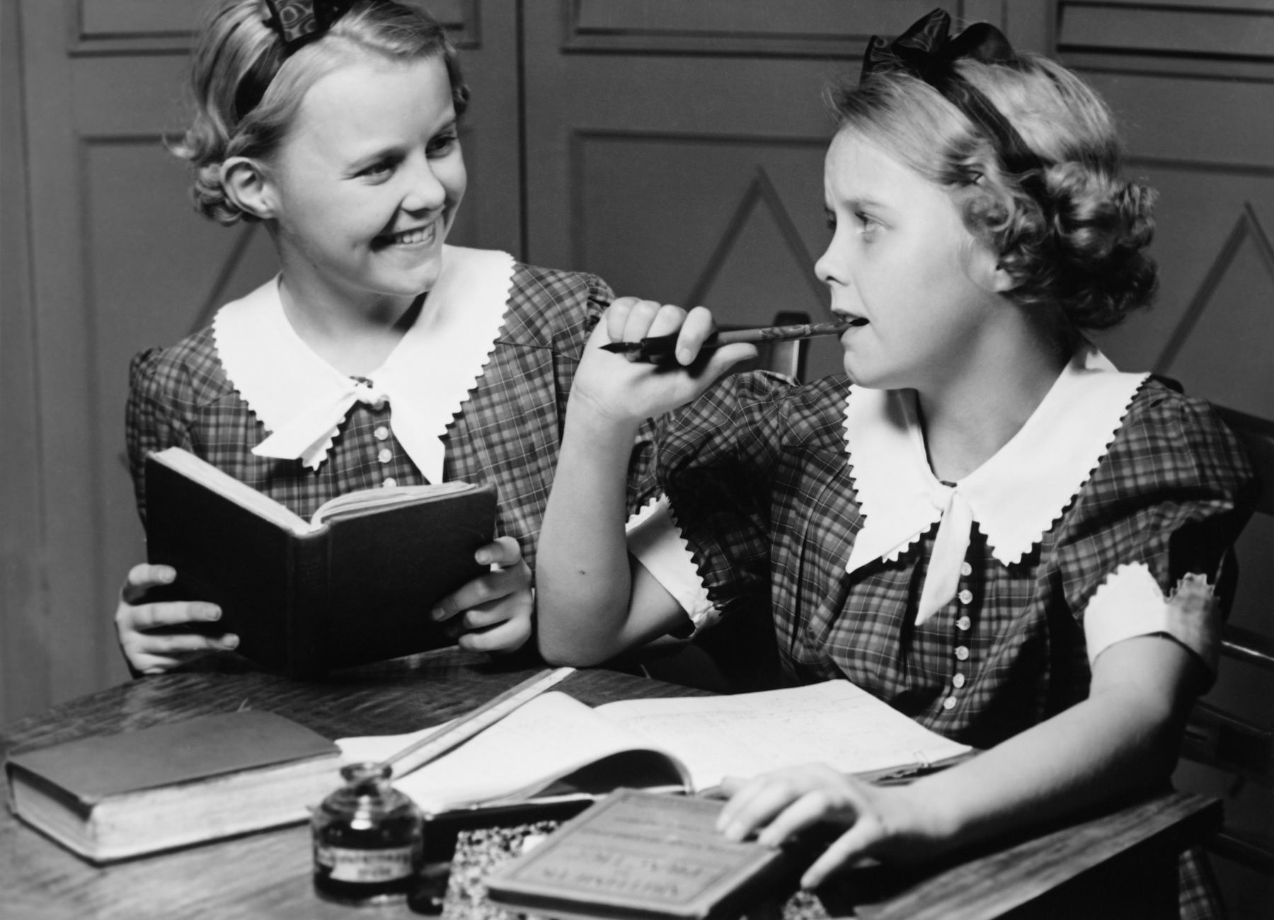 Two children writing a book - the pen is mightier
